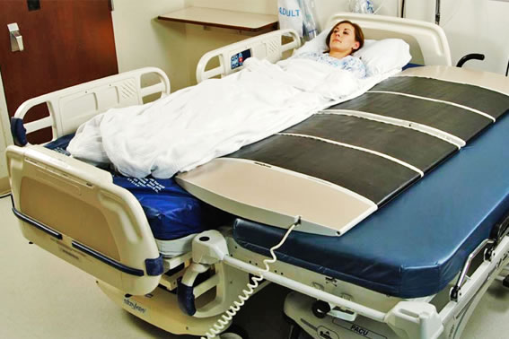 The PowerNurse transfers a patient from one hospital bed to another. © 2012 Astir Technologies